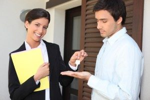 rent lease property tenant keys hand over man woman buy sell unhappy